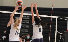 Two hitters for the Scots form a double-block to shut down an opposing play.