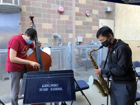 Ethan Htun (right) and Lorenzo Wolczko (left) play jazz music together during lunch with instrumental masks and covers.