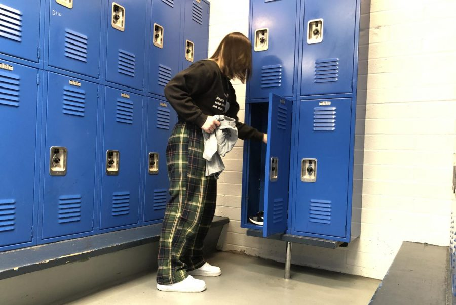 """Students change in the locker room to get ready for their PE class. """"This is a safe place to grow comfortable with changing your clothes in a public space because when you go to college, you are going to have to live with roommates,"""" Ame Secrist said."""