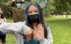 Crystal Chu performs the signature Key Club hand signal during the recent Fall Rally North preparation event in South San Francisco.