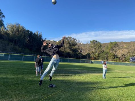 A sophomore  successfully attempts a jump serve during a volleyball game at Station 3.