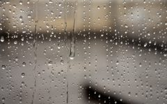 The view of rain from inside a window.