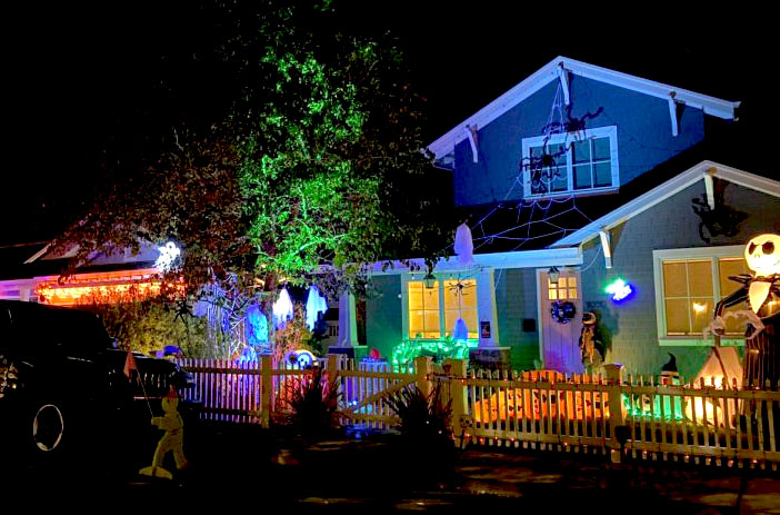 Houses on Eucalyptus Avenue shine with vibrant lights and spooky decorations.