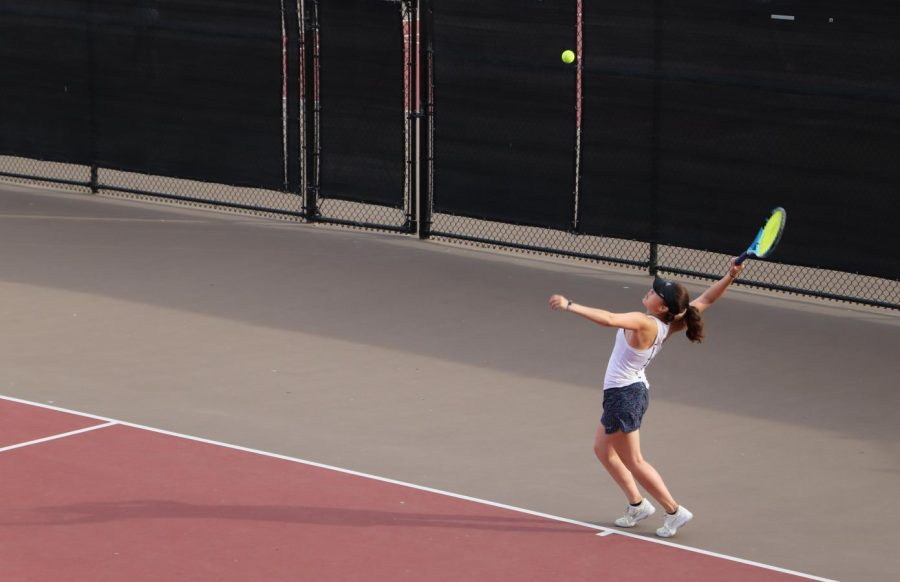 Victoria Gittoes, a senior, serves the ball to her opponent and wins a point for the Lady Scots.