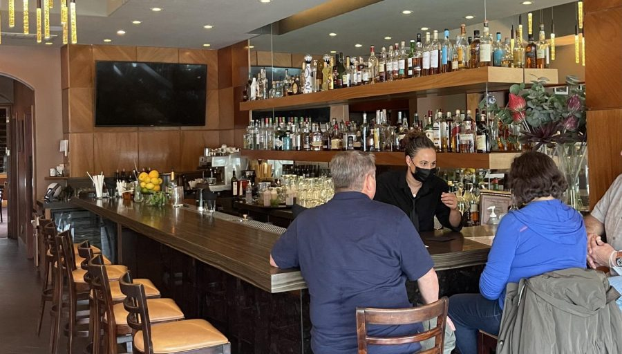 Dana Figini, the Vivace bartender, serves customers right as the restaurant opens their doors.