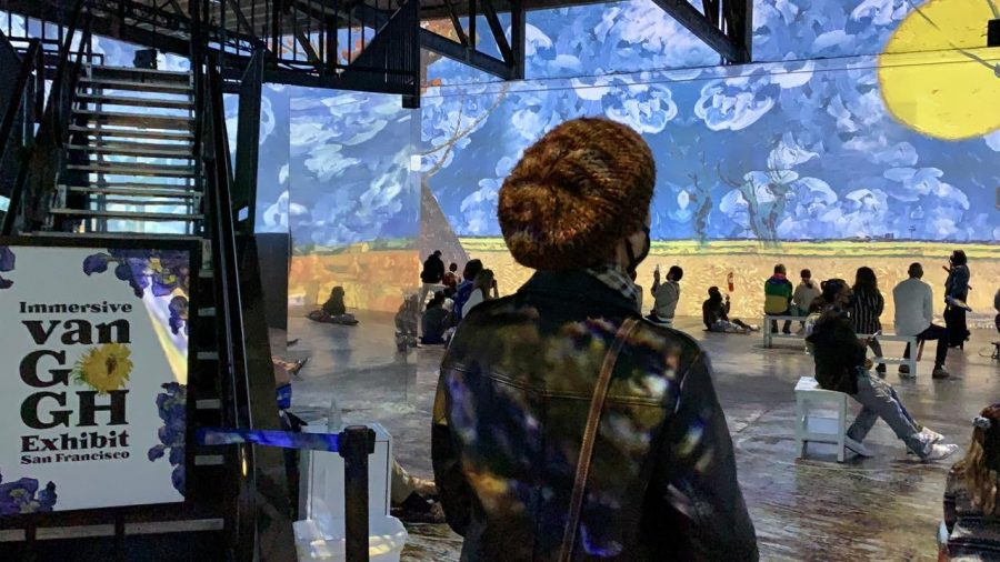 """Local artist, Sarah Ricchiuti, observes the projections at the Immersive Van Gogh Exhibit San Francisco. """"The exhibit succeeded in letting visitors see the world through the eyes of Van Gogh. I watched [the presentation] three times,"""" Ricchiuti said."""