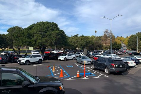 Cars pull out of Carlmonts jam-packed senior parking lot after the school day ends.