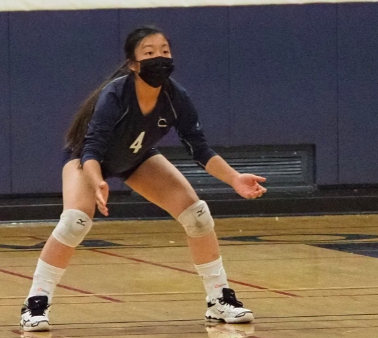 Petra Chow, a sophomore defensive specialist, prepares for a rally.