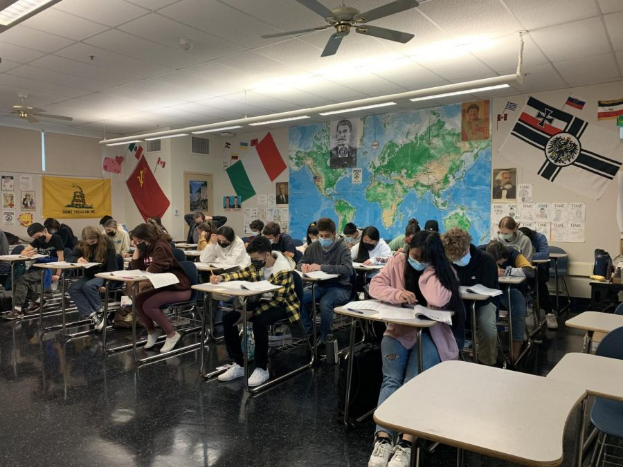 PSAT test-takers diligently answer questions under the pressing timed conditions, aiming to learn from the experience and qualify for the prestigious National Merit Scholarship.