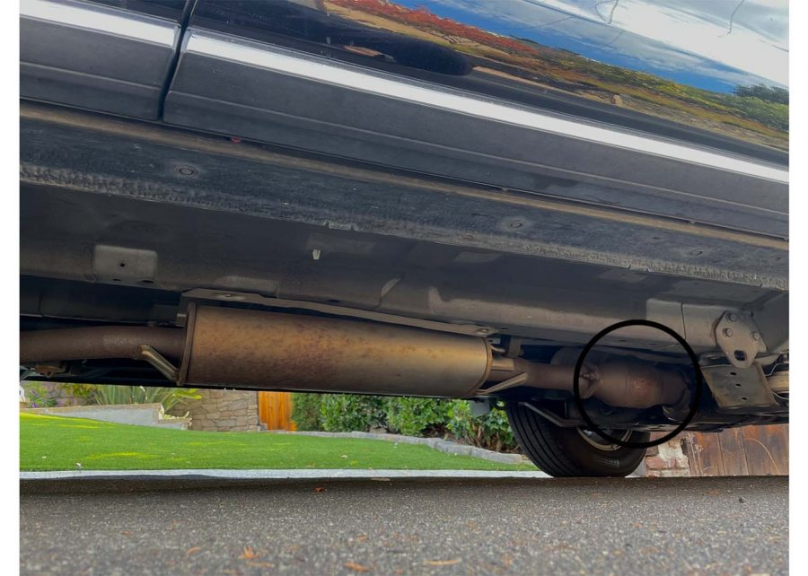 In a car, the catalytic converter sits towards the front of the car, in front of the muffler.