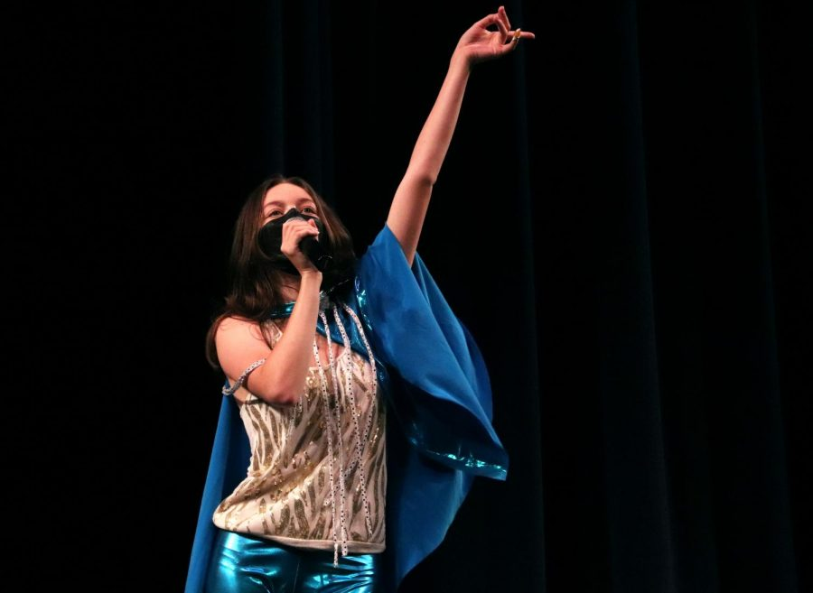 In her dazzling outfit, Marguerite Fields performs the song Waterloo by ABBA.